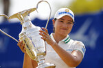 Mirim Lee, of South Korea, holds the championship trophy after winning the LPGA's ANA Inspiration golf tournament at Mission Hills Country Club in Rancho Mirage, Calif., Sunday Sept. 13, 2020. (AP Photo/Ringo H.W. Chiu)