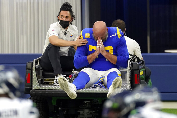 Los Angeles Rams offensive tackle Andrew Whitworth reacts as he leave the game with an injury during the second half of an NFL football game Sunday, Nov. 15, 2020, in Inglewood, Calif. (AP Photo/Ashley Landis)