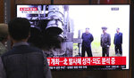 People watch a TV showing a file image of North Korean leader Kim Jong Un during a news program at the Seoul Railway Station in Seoul, South Korea, Thursday, Oct. 31, 2019. South Korea's military said North Korea on Thursday fired two projectiles toward its eastern sea, an apparent resumption of weapons tests aimed at ramping up pressure on Washington over a stalemate in nuclear negotiations. The sign reads:
