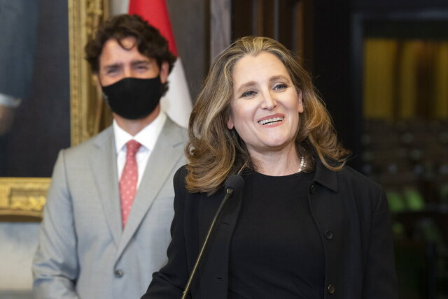 Finance Minister Chrystia Freeland smiles as she responds to a question as Prime Minister Justin Trudeau looks on during a news conference on parliament hill in Ottawa, Tuesday, Aug. 18, 2020. THE CANADIAN PRESS/Adrian Wyld/The Canadian Press via AP)