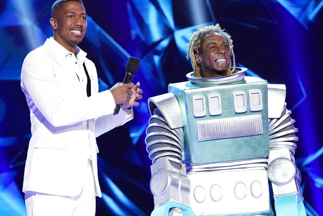 This image released by Fox shows host Nick Cannon, left, with Lil Wayne in the third season premiere of