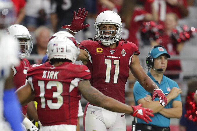 Arizona Cardinals wide receiver Christian Kirk (13) celebrate his two point conversion catch with wide receiver Larry Fitzgerald (11) during the second half of an NFL football game against the Detroit Lions, Sunday, Sept. 8, 2019, in Glendale, Ariz. (AP Photo/Darryl Webb)