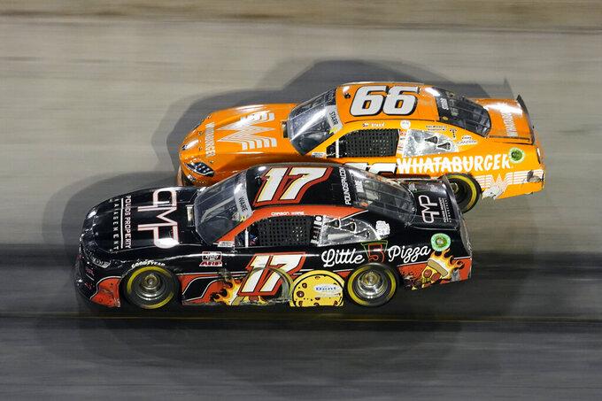 Carson Ware (17) and David Starr (66) drive through a turn during a NASCAR Xfinity Series auto race at Bristol Motor Speedway Friday, Sept. 17, 2021, in Bristol, Tenn. (AP Photo/Mark Humphrey)