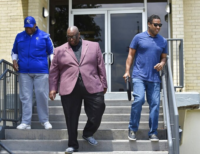 """Faith leaders with Getting to the Heart of the Matter, including from left, Revs. Ron Lindsay, Darron Edwards and Emanuel Cleaver III, leave the Missouri State Highway Patrol station in Lee's Summit, Mo., Wednesday, June 2, 2021, after presenting them with a video of the fatal police shooting of Malcolm Johnson. Highway Patrol is investigating the shooting of Johnson, who was killed at the BP gas station at E. 63rd and Prospect Avenue in March. The pastors have called the shooting """"an execution."""" (Jill Toyoshiba/The Kansas City Star via AP)"""