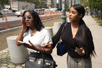 Azriel Clary, left, and Joycelyn Savage, two women who lived in Chicago with R&B singer R. Kelly, leave Brooklyn federal court following his arraignment, Friday, Aug. 2, 2019 in New York. Kelly faces charges he sexually abused women and girls. (AP Photo/Mark Lennihan)
