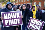 Vernon Johnson, left, a sophomore at the University of Maryland Eastern Shore, holds a sign at a rally in Annapolis, Maryland, with other students on Wednesday, Nov. 13, 2019 in support of efforts to settle a federal lawsuit that is more than a decade old involving the state's four historically black colleges. A federal judge found in 2013 that the state maintained