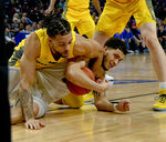 Marquette forward Theo John, left, fights for the ball against DePaul forward Jaylen Butz, right,  during the first half of an NCAA college basketball game on Tuesday, Feb. 12, 2019. in Chicago, Ill. (AP Photo/Matt Marton)