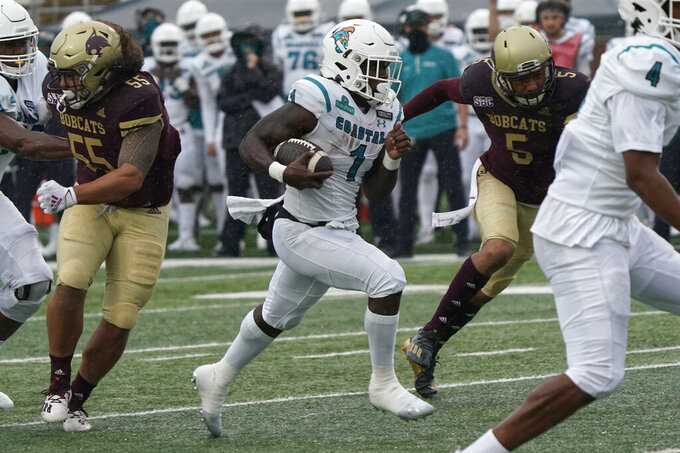 Coastal Carolina's CJ Marable (1) runs for a touchdown against Texas State during the first half of an NCAA college football game in San Marcos, Texas, Saturday, Nov. 28, 2020. (AP Photo/Chuck Burton)