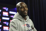 FILE - In this Oct. 23, 2019, file photo, New England Patriots free safety Devin McCourty (32) speaks with members of the media following an NFL football practice in Foxborough, Mass. The New England Patriots extended safety Devin McCourty's contract Sunday, March 15, 2020. Terms of the deal were not disclosed. (AP Photo/Steven Senne, File)