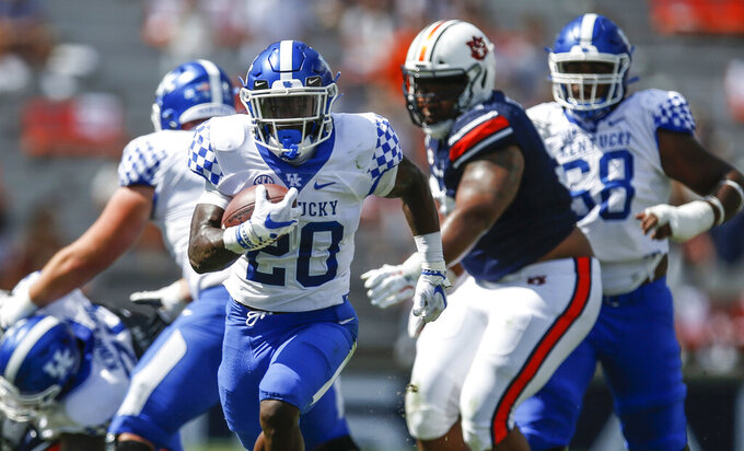 Kentucky running back Kavosiey Smoke (20) breaks free and carries the ball in for a touchdown against Auburn during the first quarter of an NCAA college football game on Saturday, Sept. 26, 2020 in Auburn, Ala. (AP Photo/Butch Dill)