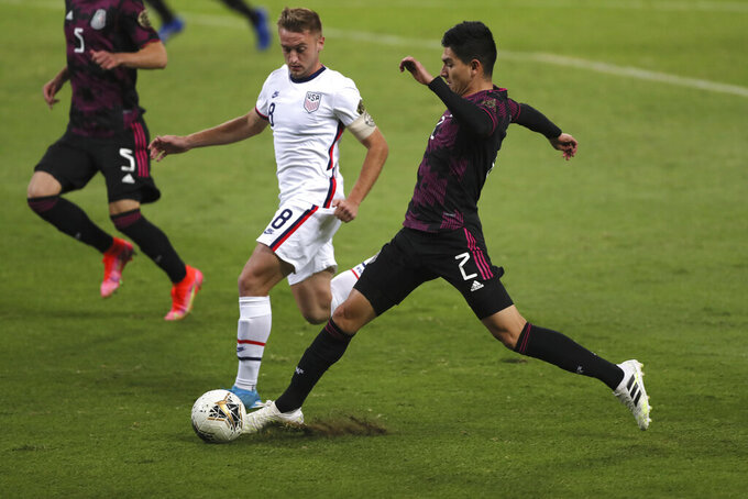 Mexico's Vladimir Lorona, right, and United States' Djordje Mihailovic compete for the ball during a Concacaf Men's Olympic Qualifying championship soccer match in Guadalajara, Mexico, Wednesday, March 24, 2021. (AP Photo/Fernando Llano)