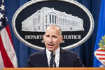 """Acting U.S. Attorney Michael Sherwin speaks during a news conference Tuesday, Jan. 12, 2021, in Washington. Federal prosecutors are looking at bringing """"significant"""" cases involving possible sedition and conspiracy charges in last week's riot at the U.S. Capitol. (Sarah Silbiger/Pool via AP)"""