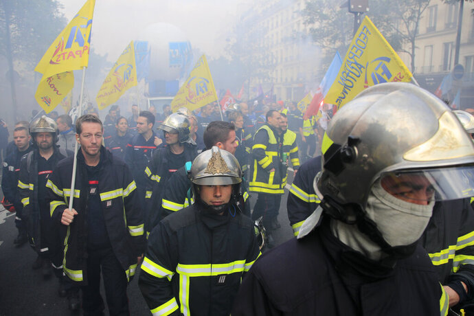 Firemen march as they protest with hospital staff on wages, working conditions and pensions, Tuesday, Oct. 15, 2019 in Paris. (AP Photo/Michel Euler)