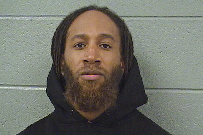 In this photo provided by the Cook County Sheriff's Office, Michael Haywood is pictured in a booking photo dated Feb. 13, 2019, in Chicago. Haywood, 34, of Evanston, was charged in February with sexual assault for a 2018 incident off campus with a 17-year-old Evanston Township High School female student. Haywood, who has pleaded not guilty, remains jailed without bond pending trial. (Cook County Sheriff's Office via AP)