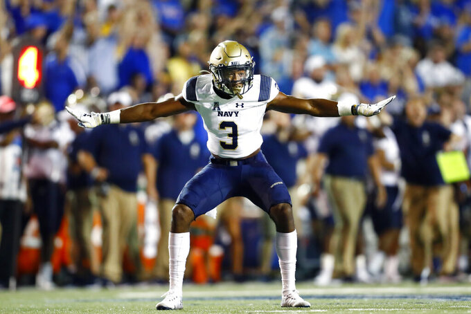 FILE - In this Thursday, Sept. 26, 2019, file photo, Navy special teams defender Cameron Kinley celebrates a missed field goal by Memphis during an NCAA college football game in Memphis, Tenn. On Tuesday, July 6, 2021, Defense Secretary Lloyd Austin said the U.S. military will allow Naval Academy graduate Kinley to pursue a career in the NFL with the Tampa Bay Buccaneers. (Joe Rondone/The Commercial Appeal via AP, File)