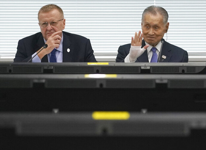 John Coates, left, chairman of the IOC Coordination Commission for the 2020 Tokyo Olympics and Paralympics, Tokyo Olympic organizing committee President Yoshiro Mori, right, pause prior to the IOC Coordination Commission opening plenary session of the Olympic Games Tokyo 2020 in Tokyo Tuesday, May 21, 2019. (AP Photo/Eugene Hoshiko)