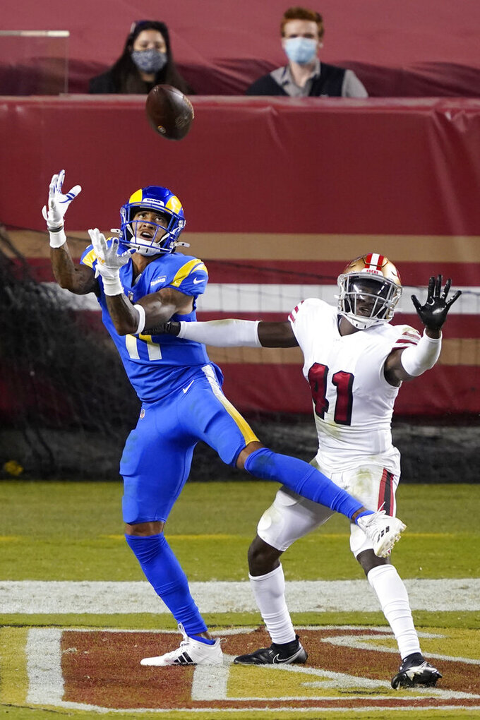 Los Angeles Rams wide receiver Josh Reynolds, left, catches a touchdown pass next to San Francisco 49ers cornerback Emmanuel Moseley (41) during the second half of an NFL football game in Santa Clara, Calif., Sunday, Oct. 18, 2020. (AP Photo/Tony Avelar)