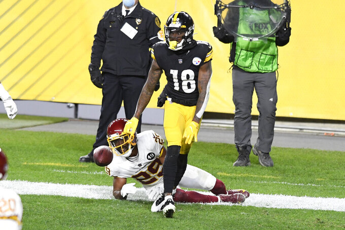 Pittsburgh Steelers wide receiver Diontae Johnson (18) begins to celebrate after catching a pass for a touchdown with Washington Football Team cornerback Kendall Fuller (29) defending during the first half of an NFL football game in Pittsburgh, Monday, Dec. 7, 2020. (AP Photo/Barry Reeger)