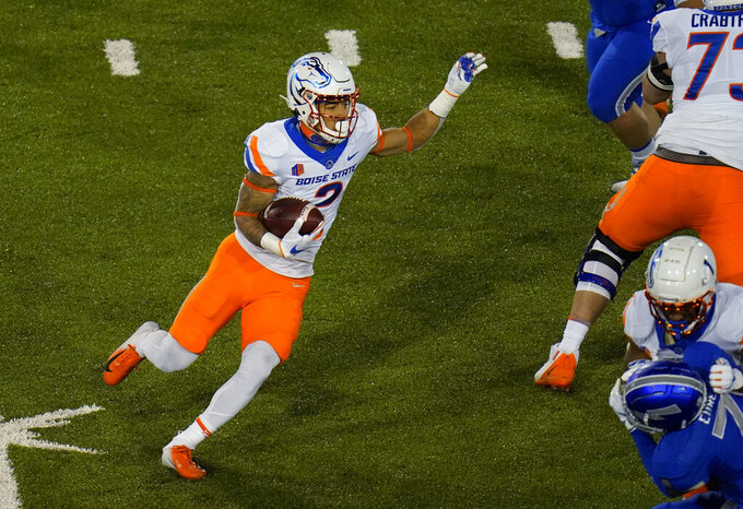 Boise State wide receiver Khalil Shakir carries the ball during the second half of the team's NCAA college football game against Air Force on Saturday, Oct. 31, 2020, at Air Force Academy, Colo. (AP Photo/David Zalubowski)