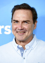 """FILE - Norm Macdonald arrives at the NBC Universal Summer Press Day in Pasadena, Calif., on April 2, 2015. Macdonald, a comedian and former cast member on """"Saturday Night Live,"""" died Tuesday, Sept. 14, 2021, after a nine-year battle with cancer that he kept private, according to Brillstein Entertainment Partners, his management firm in Los Angeles. He was 61. (Photo by Chris Pizzello/Invision/AP, File)"""