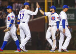 Chicago Cubs' David Bote, center right, celebrates with Kris Bryant, center left, after the Cubs defeated the Colorado Rockies 9-8 in a baseball game Wednesday, June 5, 2019, in Chicago. (AP Photo/Kamil Krzaczynski)