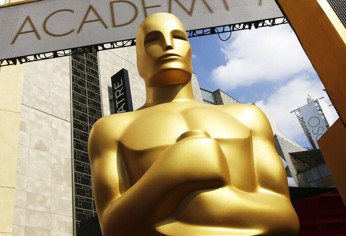 FILE - In this Feb. 21, 2015 file photo, an Oscar statue appears outside the Dolby Theatre for the 87th Academy Awards in Los Angeles. The 94th Oscars will be held on March 27, 2022. (Photo by Matt Sayles/Invision/AP, File)