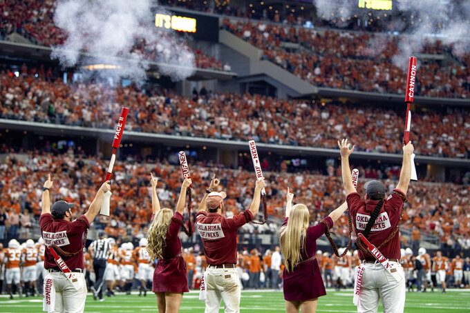 The Oklahoma Rufneks fire off blanks after a field goal against Texas during the second half of the Big 12 Conference championship NCAA college football game on Saturday, Dec. 1, 2018, in Arlington, Texas. Oklahoma won 39-27. (AP Photo/Jeffrey McWhorter)