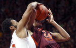 Braxton Key (2) of UVa blocks a shot by Kerry Blackshear Jr. (24) of Virginia Tech in the second half of the Virginia Tech - University of Virginia NCAA basketball game in Blacksburg Va. Monday February 18 2019. Virginia won the game 64-58. (Matt Gentry/The Roanoke Times via AP)
