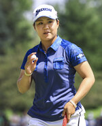 Nasa Hataoka holds up the ball after making par on the eighth hole during the second round the LPGA Marathon Classic golf tournament Friday, July 9, 2021, at Highland Meadows in Sylvania, Ohio. (Jeremy Wadsworth/The Blade via AP)