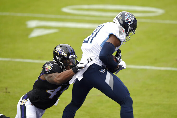 Tennessee Titans tight end Jonnu Smith (81) makes a touchdown catch against Baltimore Ravens linebacker Chris Board during the first half of an NFL football game, Sunday, Nov. 22, 2020, in Baltimore. (AP Photo/Gail Burton)