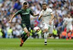 Betis player Lo Celso, left, duels for the ball against Real Madrid's Nacho Fernanzez during a Spanish La Liga soccer match at the Santiago Bernabeu stadium in Madrid, Spain, Sunday, May 19, 2019. (AP Photo/Bernat Armangue)