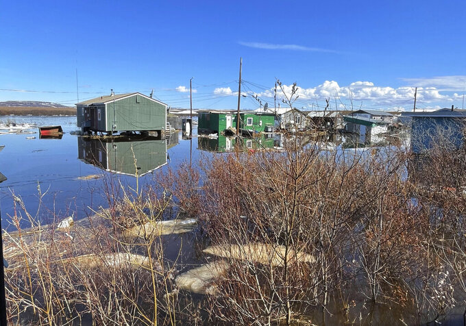 This photo provided by Nathan Hadley Jr. shows flooding in the village of Buckland, Alaska, on Thursday, May 13, 2021. An ice jam on the Buckland River, a half mile below the community, has caused the entire village of about 500 residents in northwest Alaska to be completely inundated. (Nathan Hadley Jr. via AP)