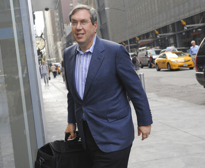 FILE- In this July 8, 2011, file photo, attorney Jeffrey Kessler enters a Manhattan law office in New York. Several people familiar with the conversations tell The Associated Press that the baseball players' association has discussed hiring the noted sports lawyer to litigate a contemplated grievance. In divisive talks reminiscent of baseball's eight work stoppages from 1972-95, the sides failed to reach an economic agreement last month. (AP Photo/Louis Lanzano, File)