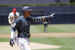 San Diego Padres' Manny Machado reacts after hitting a two-run home run during the first inning of a baseball game against the St. Louis Cardinals, Sunday, June 30, 2019, in San Diego. (AP Photo/Gregory Bull)