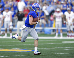 Kansas quarterback Peyton Bender (7) runs for a first down against Nicholls State during the first quarter of an NCAA college football game in Lawrence, Kan., Saturday, Sept. 1, 2018. (AP Photo/Reed Hoffmann)