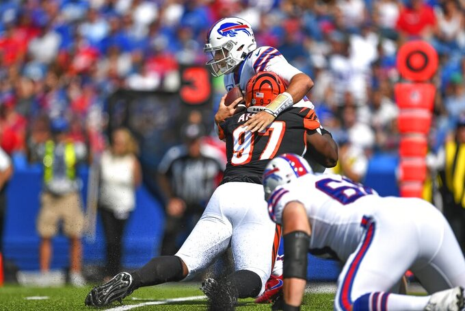 CORRECTS DATE - Cincinnati Bengals' Geno Atkins (97) sacks Buffalo Bills quarterback Josh Allen (17) during the first half of an NFL football game Sunday, Sept. 22, 2019, in Orchard Park, N.Y. (AP Photo/Adrian Kraus)