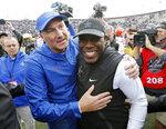 Florida head coach Dan Mullen, left, and Vanderbilt head coach Derek Mason meet on the field after an NCAA college football game Saturday, Oct. 13, 2018, in Nashville, Tenn. Florida won 37-27. (AP Photo/Mark Humphrey)