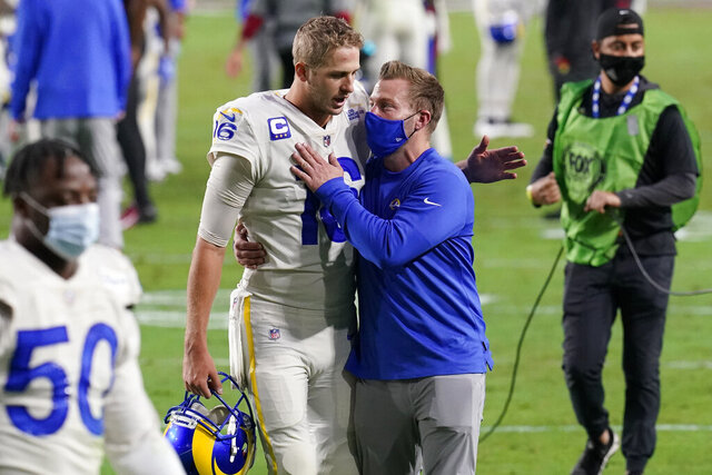 Los Angeles Rams head coach Sean McVay greets quarterback Jared Goff (16) after an NFL football game against the Arizona Cardinals, Sunday, Dec. 6, 2020, in Glendale, Ariz. The Rams won 38-28. (AP Photo/Ross D. Franklin)