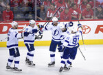Tampa Bay Lightning defenseman Victor Hedman (77), of Sweden, celebrates his goal with Nikita Kucherov (86), Steven Stamkos (91), Ondrej Palat (18), and Dan Girardi (5) during the second period of Game 3 of the NHL Eastern Conference finals hockey playoff series against the Washington Capitals, Tuesday, May 15, 2018 in Washington. (AP Photo/Nick Wass)