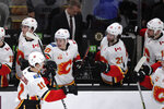 Calgary Flames center Mikael Backlund (11) is congratulated after his goal against Boston Bruins goaltender Tuukka Rask during the third period of an NHL hockey game in Boston, Tuesday, Feb. 25, 2020. Backlund scored twice in the Flames 5-2 win. (AP Photo/Charles Krupa)