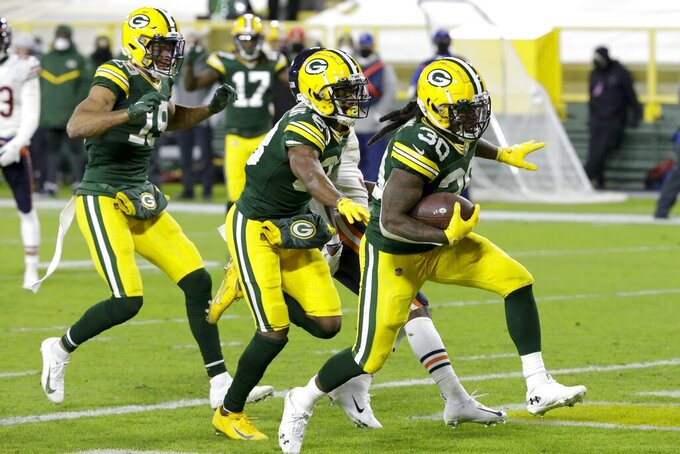 Green Bay Packers' Jamaal Williams runs for a rtouchdown during the second half of an NFL football game against the Chicago Bears Sunday, Nov. 29, 2020, in Green Bay, Wis. (AP Photo/Mike Roemer)