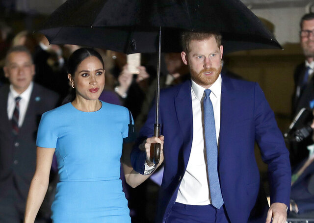 FILE - In this March 5, 2020 file photo, Britain's Prince Harry and Meghan, the Duke and Duchess of Sussex arrive at the annual Endeavour Fund Awards in London. Britain's Prince Harry says it took him many years and the experience of living with his wife, the former Meghan Markle, to understand how his privileged upbringing shielded him from the reality of unconscious bias. (AP Photo/Kirsty Wigglesworth, File)