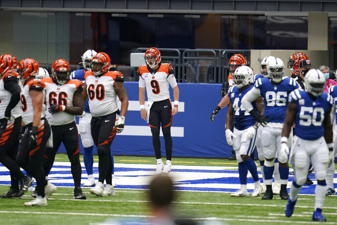 Cincinnati Bengals quarterback Joe Burrow (9) reacts after rushing for a touchdown during the first half of an NFL football game against the Indianapolis Colts, Sunday, Oct. 18, 2020, in Indianapolis. (AP Photo/Michael Conroy)