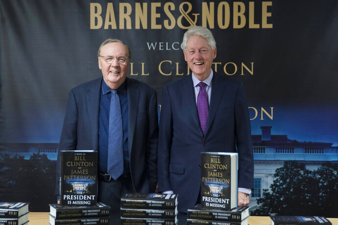 FILE - In this June 5, 2018 file photo, former President Bill Clinton, right, and author James Patterson pose for photographers during an event to promote their new novel,