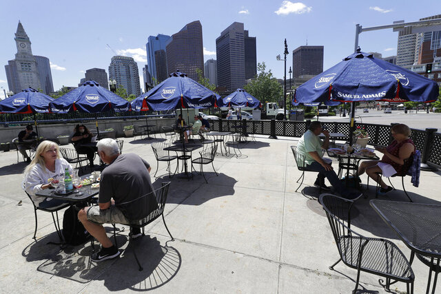 Diners eat outdoors at Mother Anna's restaurant, Monday, June 8, 2020, in Boston's North End neighborhood. Restaurants in Massachusetts can start offering outdoor dining, with the restriction that tables be placed at least six feet apart, on Monday, June 8, as phase 2 of the state's reopening during the coronavirus pandemic kicks in. (AP Photo/Steven Senne)