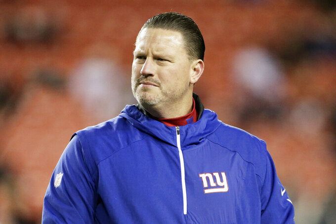 FILE - In this Nov. 23, 2017, file photo, New York Giants coach Ben McAdoo stands on the field before the team's NFL football game against the Washington Redskins in Landover, Md. The Jacksonville Jaguars have hired former New York Giants head coach Ben McAdoo as quarterbacks coach. McAdoo replaces Scott Milanovich, who left at the end of last season to take the head coaching job with the CFL's Edmonton Eskimos. (AP Photo/Mark Tenally, File)