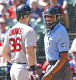 Boston Red Sox batter Chris Owings talks with umpire CB Bucknor after being called out on strikes in the third inning of a baseball game against the Texas Rangers, Thursday, Sept. 26, 2019, in Arlington, Texas. (AP Photo/Louis DeLuca)