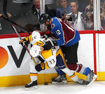 Colorado Avalanche defenseman Patrik Nemeth, hits Nashville Predators left wing Viktor Arvidsson as he tries to control the puck in the first period of Game 3 of an NHL hockey first-round playoff series Monday, April 16, 2018, in Denver. (AP Photo/David Zalubowski)