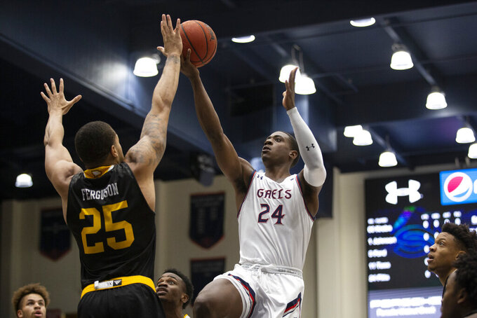 Saint Mary's forward Malik Fitts (24) shoots over Winthrop forward Josh Ferguson (25) during the first half of an NCAA college basketball game, Monday, Nov. 11, 2019 in Moraga, Calif. (AP Photo/D. Ross Cameron)
