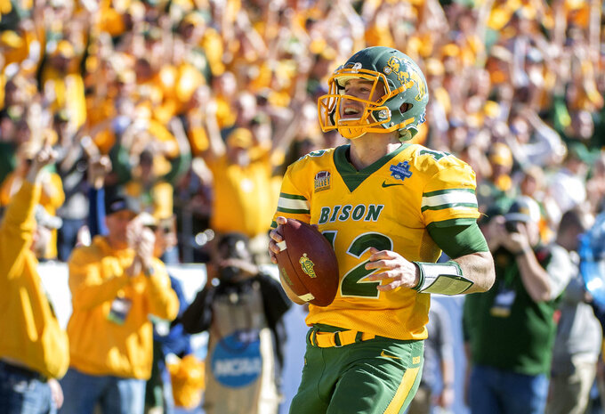 North Dakota State quarterback Easton Stick (12) smiles as he scores the final touchdown of the game against Eastern Washington during the second half of the FCS championship NCAA college football game, Saturday, Jan. 5, 2019, in Frisco, Texas. North Dakota State won 38-24. (AP Photo/Jeffrey McWhorter)